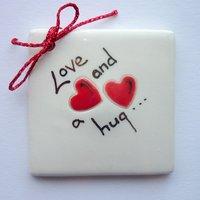 Love and a hug tile tag 5cm sq