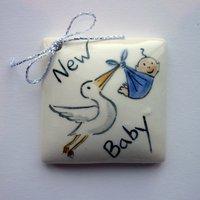 Stork & baby tile tag 5cm sq